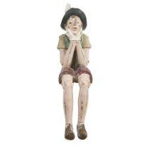 KL Pinokkió dekofigura 4x7x15cm,ülő-könyöklős, műanyag